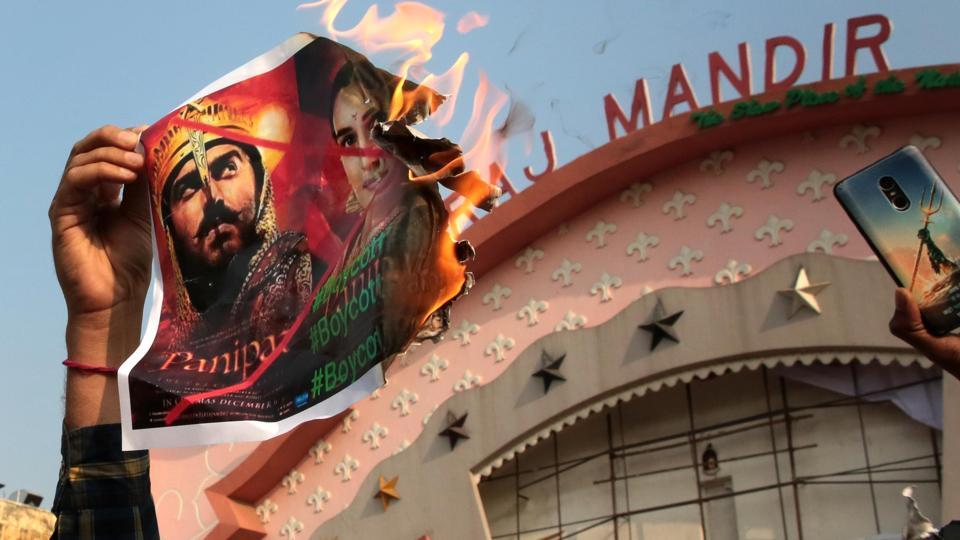 Rashtriya Loktantrik Party and members of  the Jat community burn poster of the film Panipat outside Raj Mandir in Jaipur on Monday.
