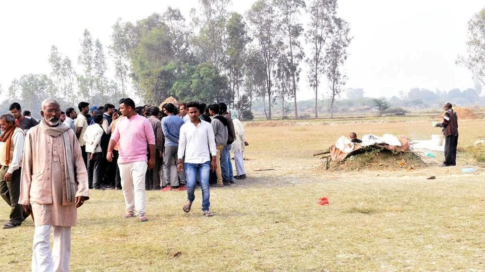 Villagers during the funeral procession of Unnao rape and burns victim, at her village in Unnao.