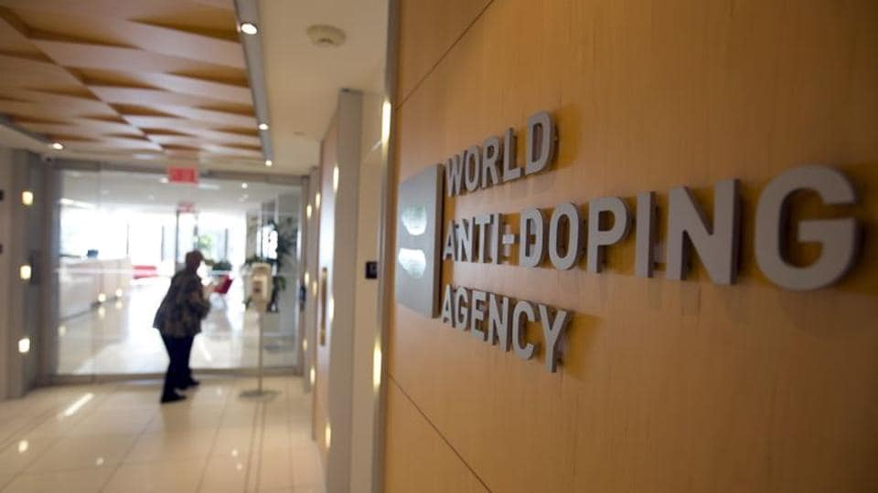 A woman walks into the head office for the World Anti-Doping Agency (WADA) in Montreal, Quebec.