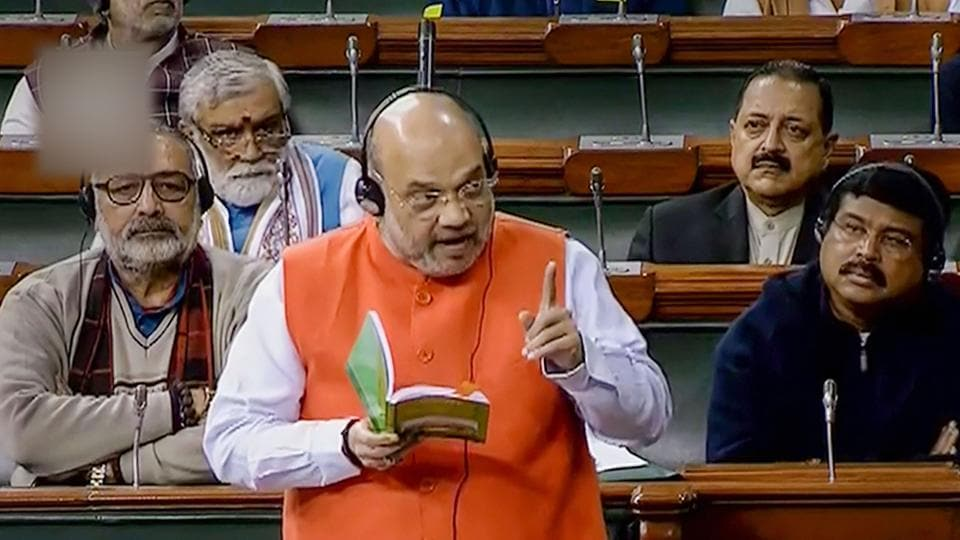 Union Home Minister Amit Shah speaks in the Lok Sabha during the ongoing Winter Session of Parliament, in New Delhi, Monday,