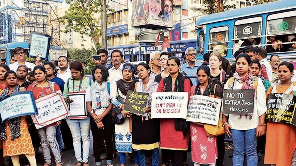 Activists stage a protest against rising rape cases in the country, at Hazra crossing in Kolkata on Monday.