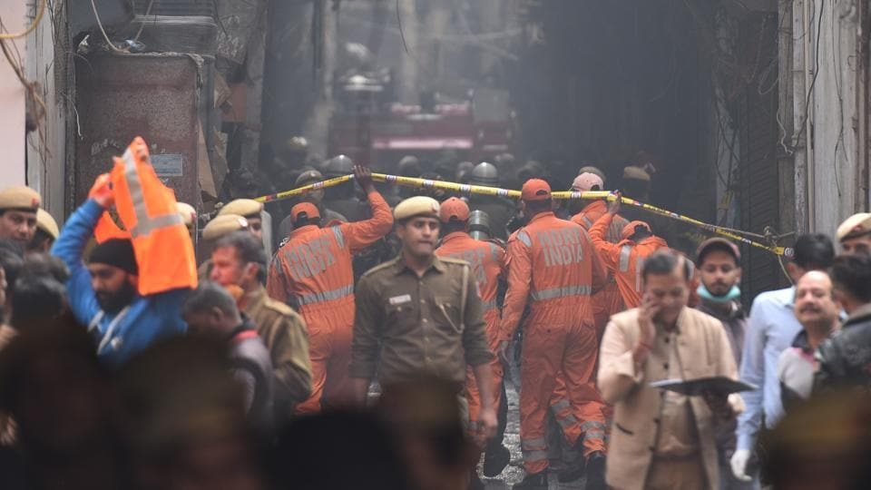 National Disaster Response Force (NDRF) personnel deployed at the spot where a fire broke out in a plastic factory, at Anaj Mandi, Filmistan, in New Delhi