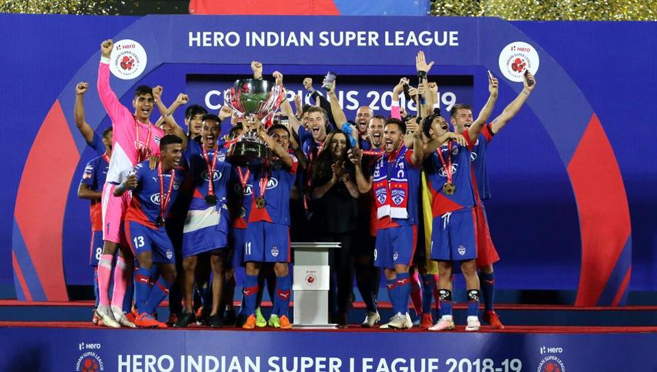 Bengaluru FC players with the ISL trophy.