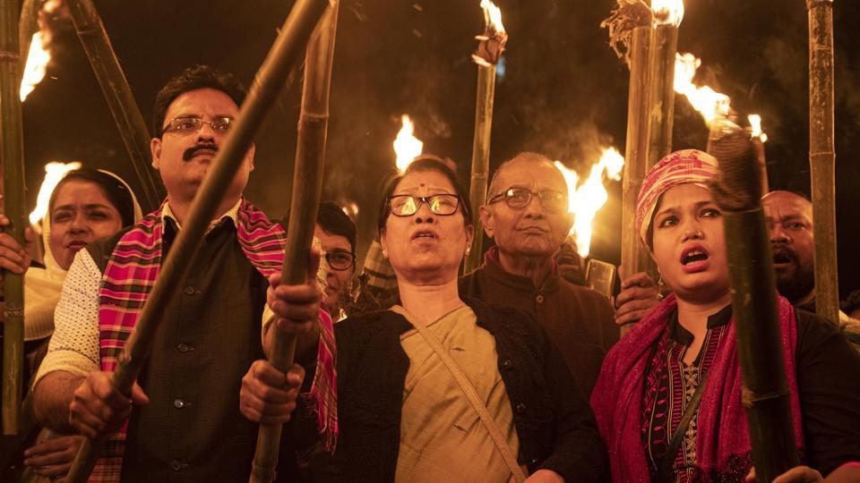 Activists participate in a torch light procession to protest against the Citizenship Amendment Bill (CAB) in Gauhati.