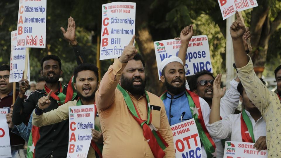 Activists holds placards and shouts slogans during a protest against Citizenship Amendment Bill (CAB) in Ahmadabad.