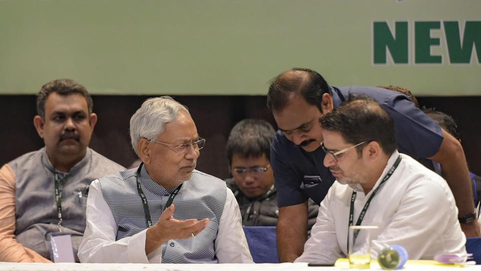 Bihar Chief Minister Nitish Kumar and party National Vice-President Prashant Kishor attend the Janata Dal (United) JD(U)'s national council meet, in New Delhi.