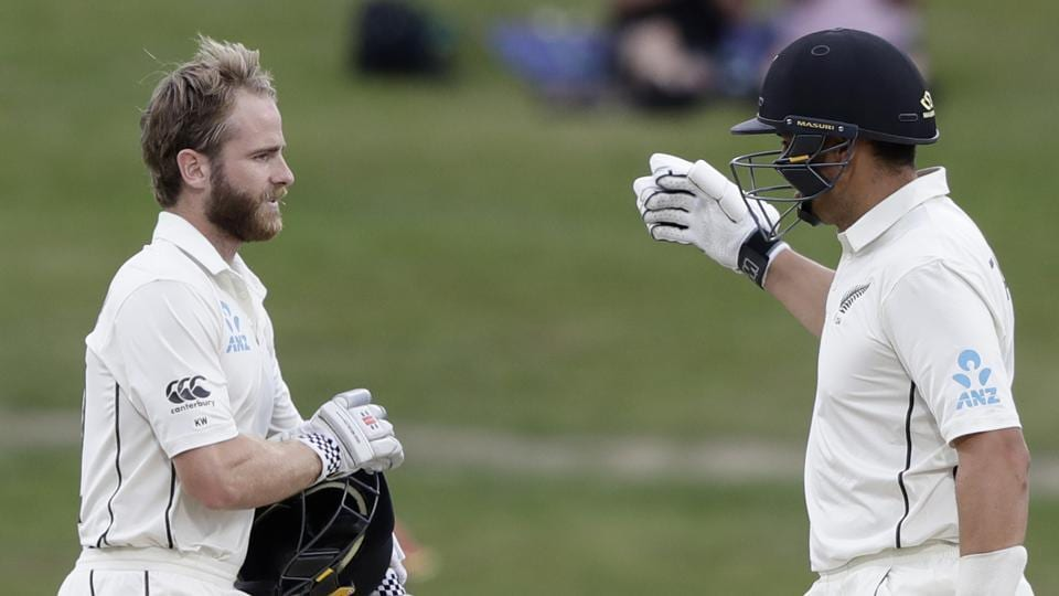 New Zealand's Kane Williamson, left, and teammate Ross Taylor