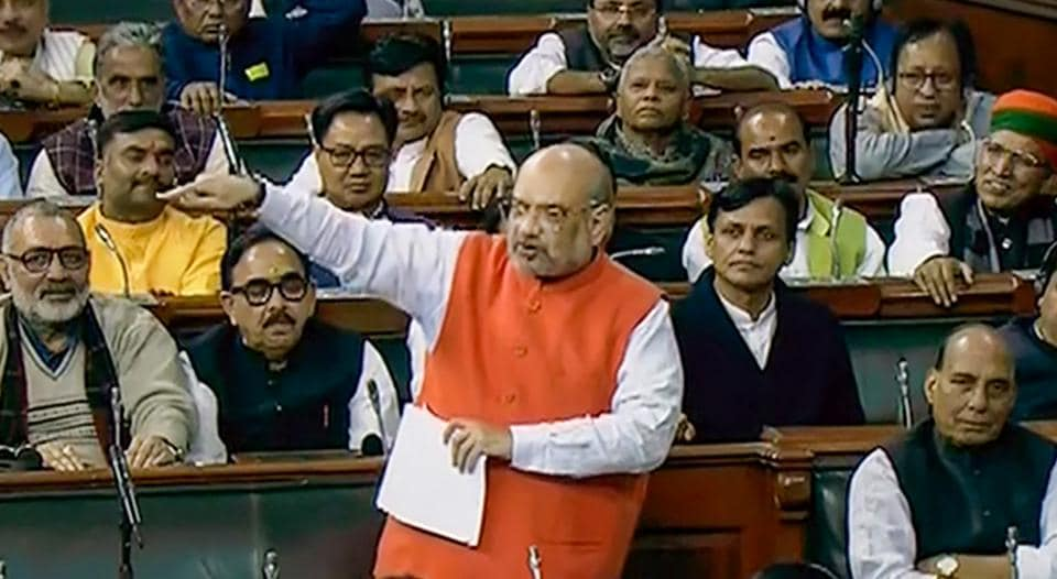 Union Home Minister Amit Shah speaks in the Lok Sabha during the ongoing Winter Session of Parliament, in New Delhi, Monday, Dec. 9, 2019.