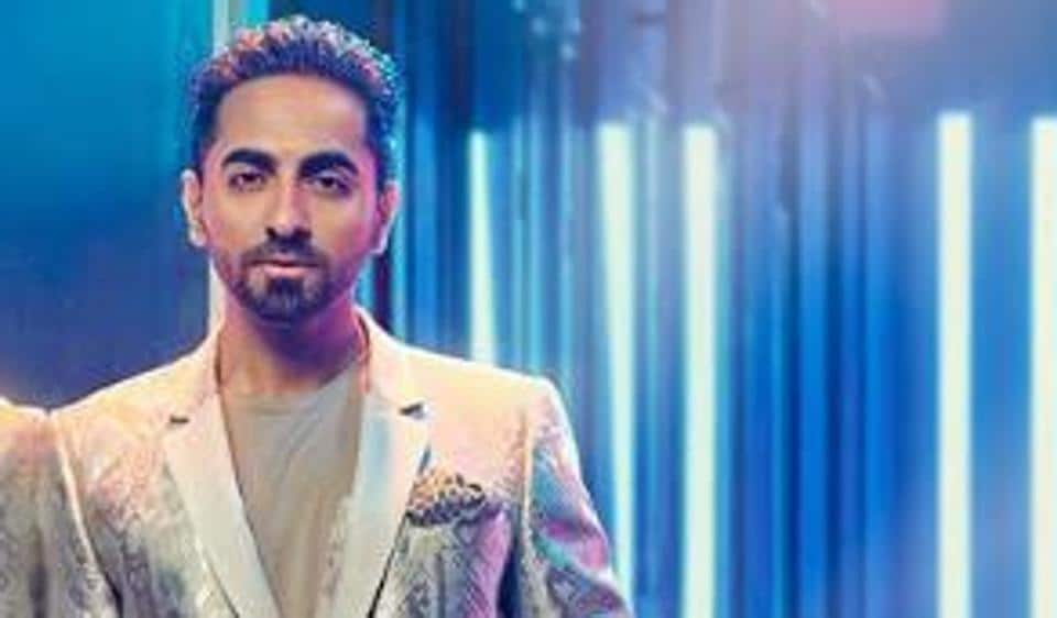 Ayushmann Khurrana looks dapper in the silver jacket and slick hair pulled back.