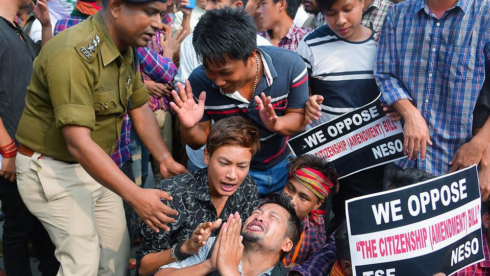A man requesting police officer as he is being detained during a protest against the Citizenship Amendment Bill (CAB), in Agartala on Dec 11, 2019. (ANI Photo)