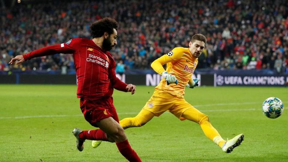 Liverpool's Mohamed Salah scores their second goal.