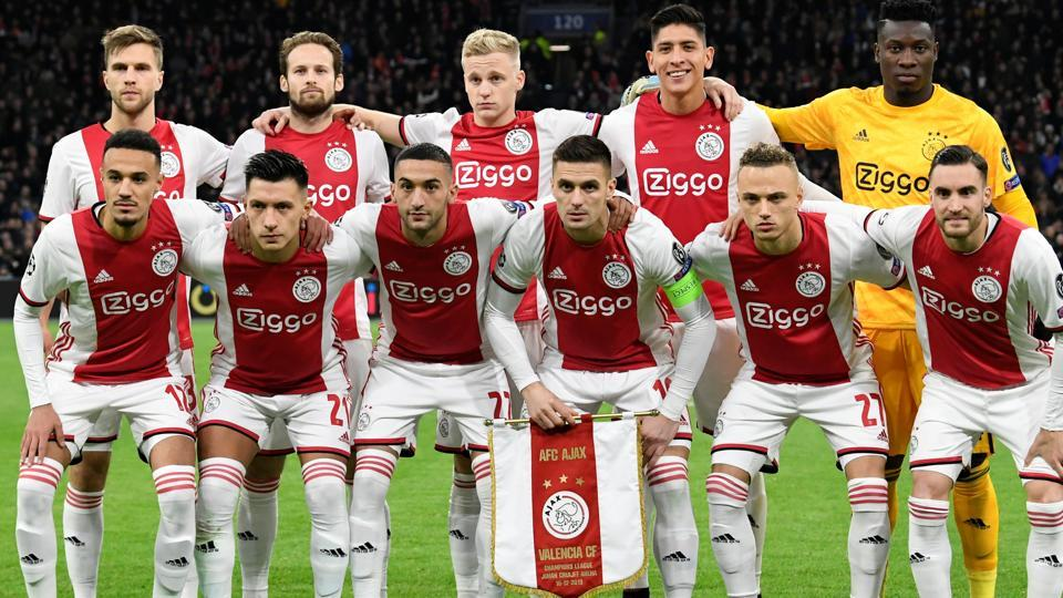 Ajax Amsterdam players pose for a team group photo before the match.