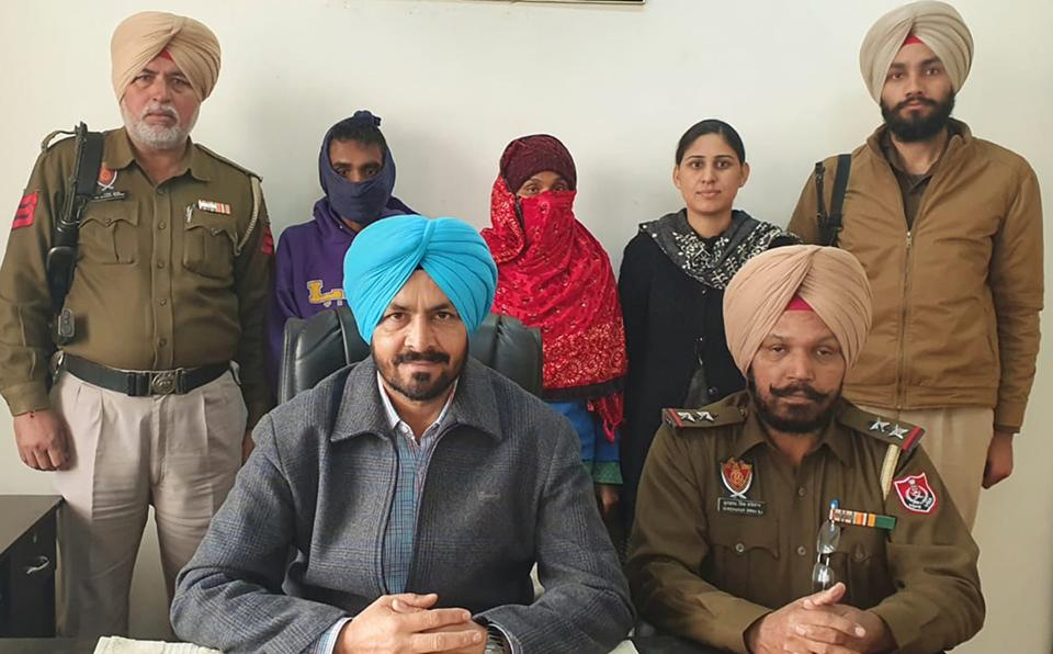 The accused (faces covered) in Ludhiana STF custody on Wednesday.