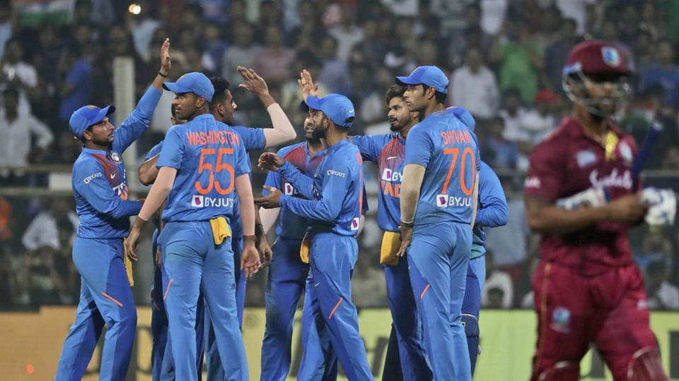 Indian cricketers celebrate.