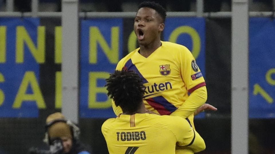 Barcelona's Ansu Fati, up, celebrates after scoring his side's second goal.