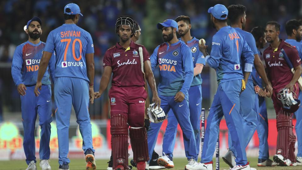 West Indies' Nicholas Pooran, third left, and Lendl Simmons, third right, shake hands with Indian players.
