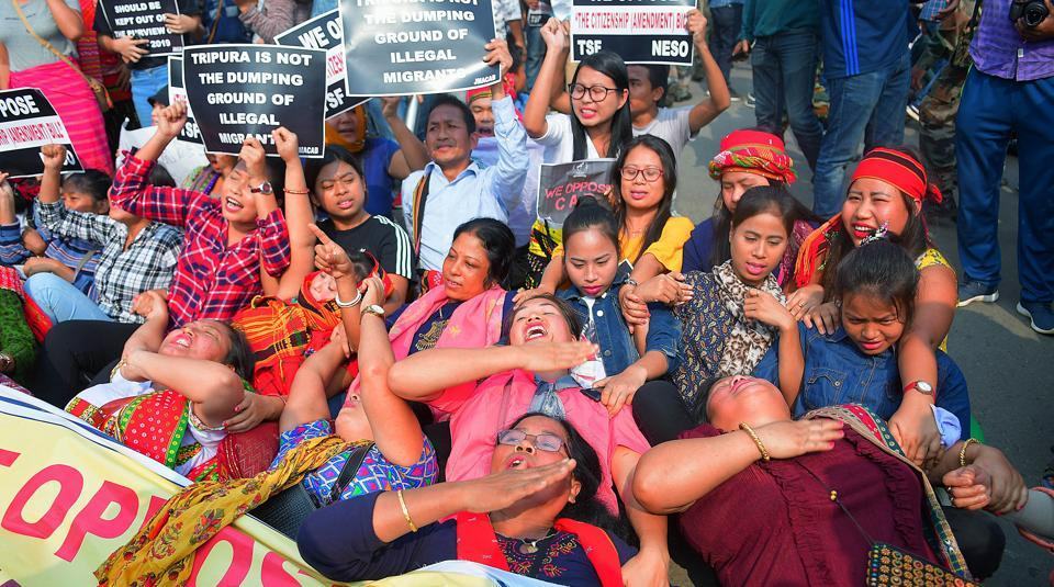 Protesters hold placards and raise slogans against the Citizenship Amendment Bill (CAB), during the shutdown called by North East Students' Organization (NESO), in Agartala on Tuesday.