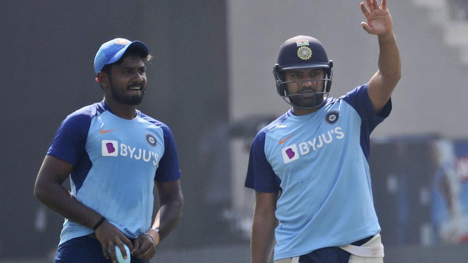 India's Rohit Sharma, right, gestures during a training session.