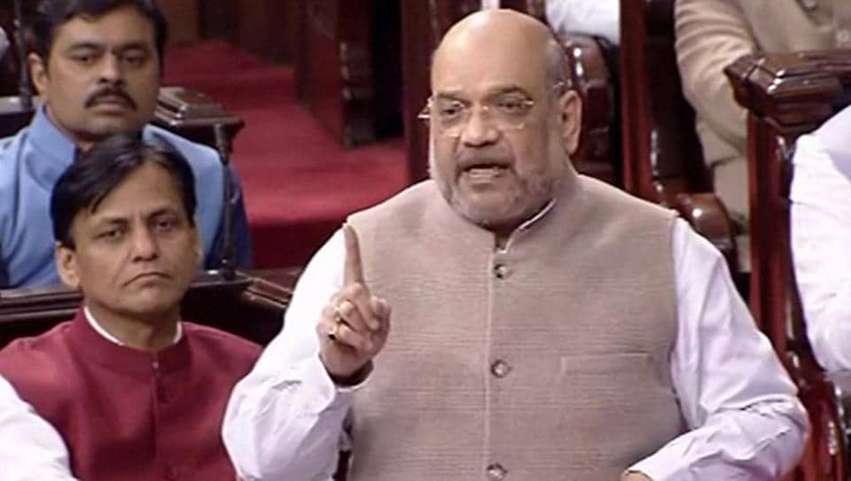 Union Home Minister Amit Shah speaks in the Rajya Sabha during the Winter Session of Parliament, in New Delhi, Wednesday, Dec. 11, 2019.