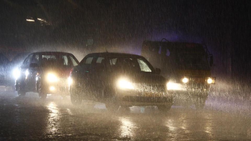 Vehicles move at Gurugram amid Heavy Rain on a winter, in Gurugram, India, on Thursday night, 12 December 2019.