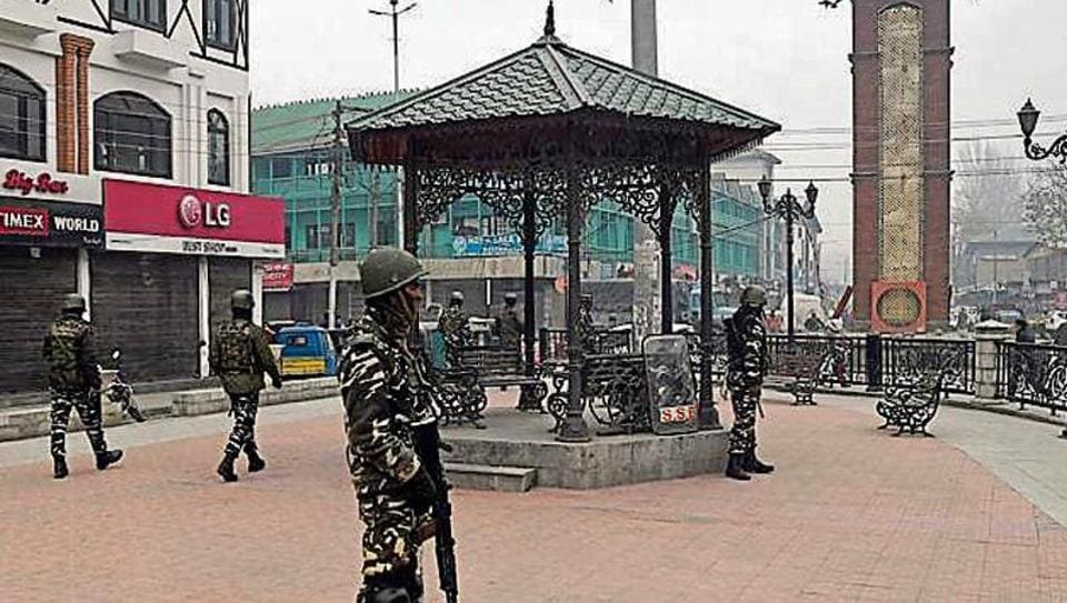 CRPF personnel patrol in front of closed market at Lal Chowk in Srinagar on Thursday.