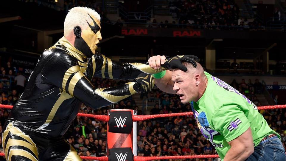 Goldust in action with John Cena.