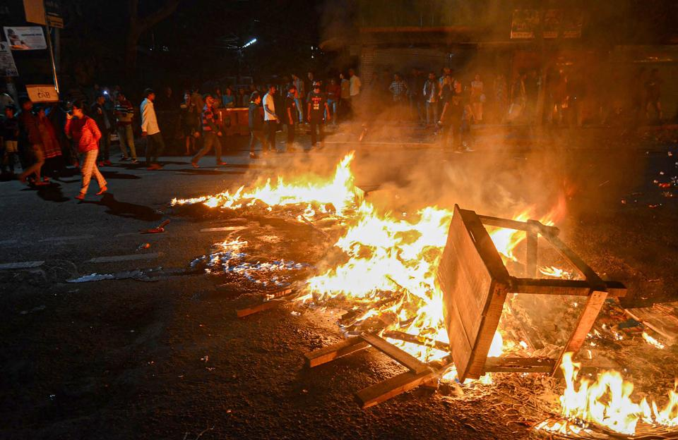 Protestors burn tyres and public property on road during a protest against the Citizenship (Amendment) Bill, 2019, in Guwahati on Wednesday.