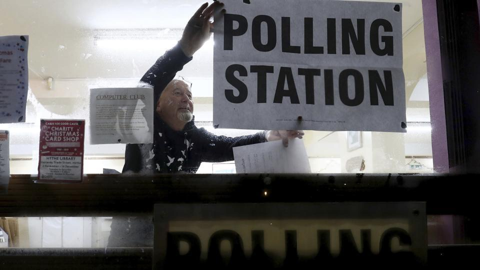 A polling station is set-up as voters go to the polls in a General Election, in Lydd, southern England, Thursday Dec. 12, 2019.