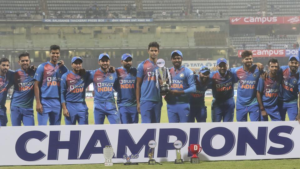 Players of Indian cricket team pose with the winner's trophy.