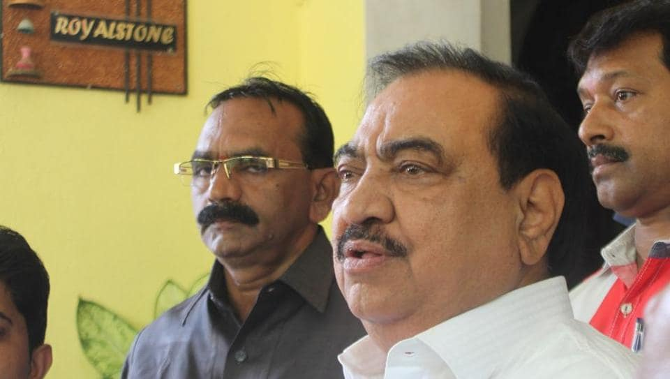 BJP leader Eknath Khadse leaves after meeting with party leader Pankaja Munde at her residence in Mumbai, on Tuesday.