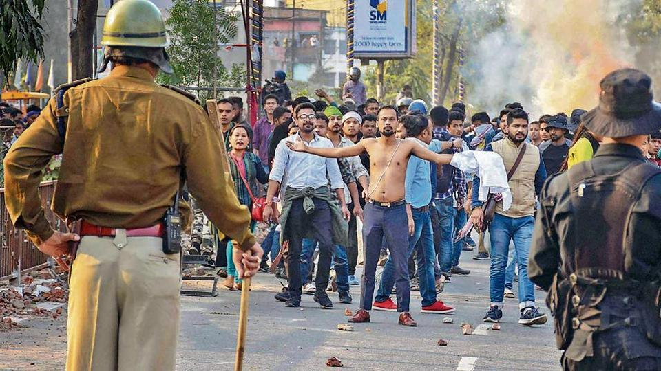 Protestors, amid tear-smoke clash with the police during their march against the Citizenship (Amendment) Bill, 2019, in Guwahati, Wednesday, Dec. 11, 2019.