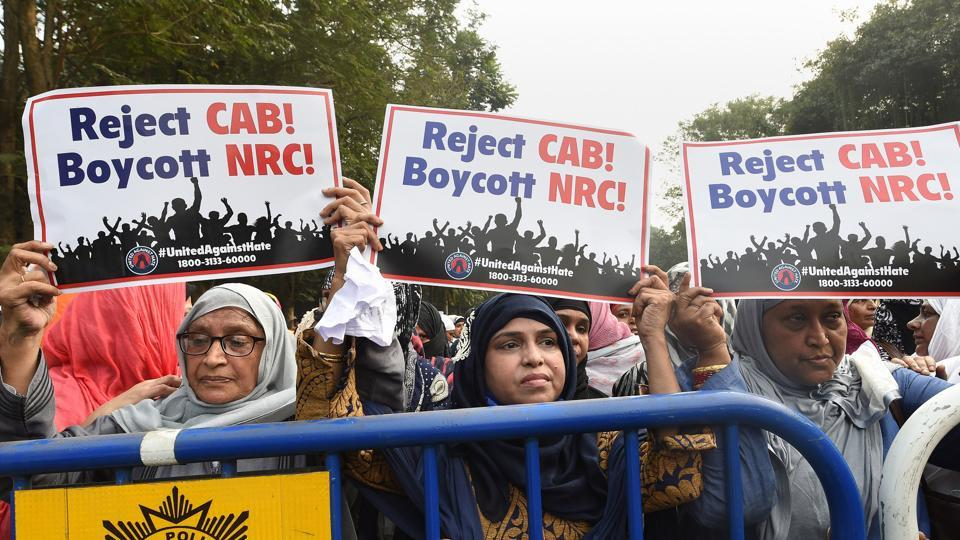 Muslim women take part in a protest rally against CAB and NRC, in Kolkata.