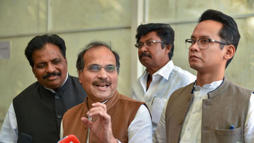 Congress leader Adhir Ranjan Chowdhury addresses the media as MP Gaurav Gogoi looks on, during the ongoing Winter Session, at Parliament House in New Delhi.