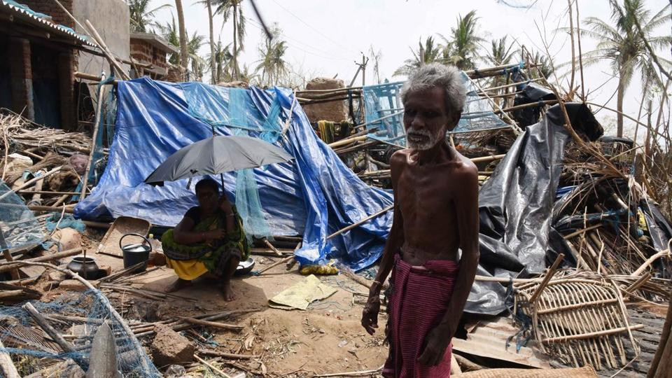 A man and a woman seen amid destruction in the aftermath of Cyclone Fani, at Satapada, in Puri district of Odisha.