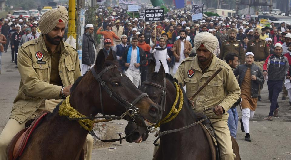 Members of Muslim community carrying out a protest march in Ludhiana on Saturday.