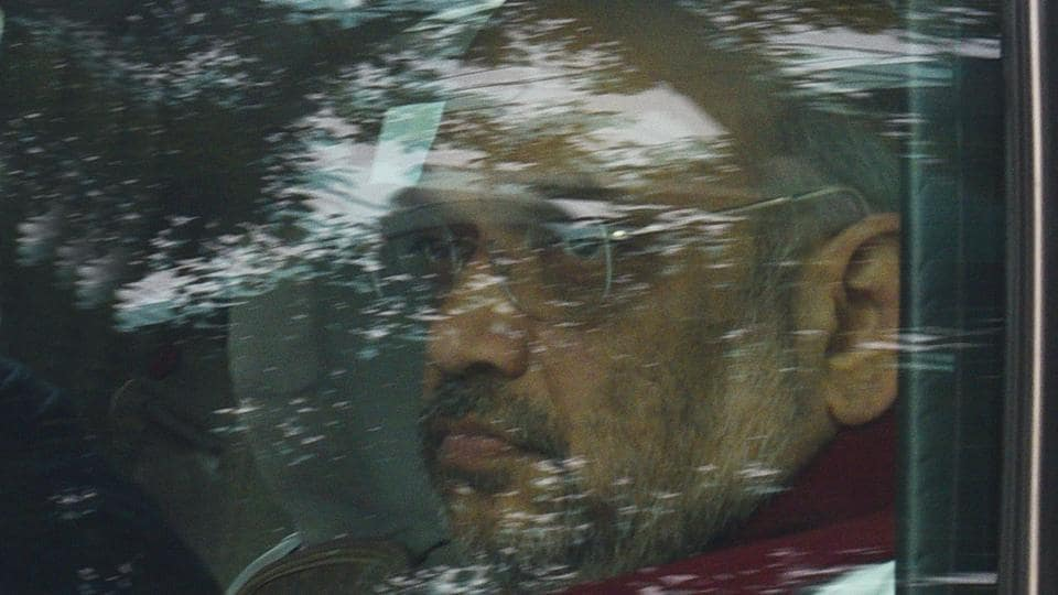 Home Minister Amit Shah arrives during the winter session of Parliament in New Delhi.