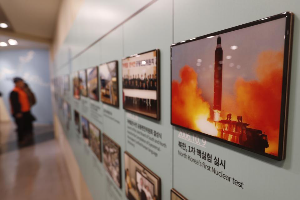 In this Friday, Dec. 13, 2019, photo, an image showing North Korea's missile launch is displayed at the Unification Observation Post in Paju, South Korea, near the border with North Korea. North Korea on Saturday, Dec. 14, says it successfully performed another