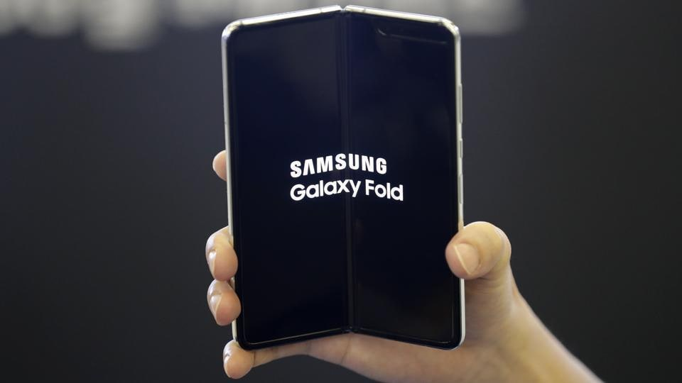 An employee holds the Samsung Electronics Co.'s Galaxy Fold for a photograph at a shopping mall in Seoul, South Korea.