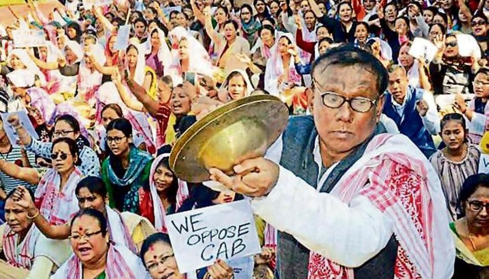 A man plays cymbals as protestors gather during an agitation against the passing of Citizenship Amendment Bill, in Dibrugarh, Saturday, Dec. 14, 2019.