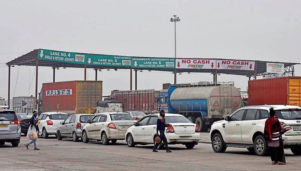 Vehicles in the FASTag lane at Bhagan Toll Plaza, in Murthal, Haryana, India, on Friday, December 13, 2019.