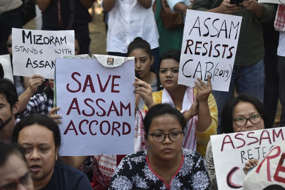 People from Assam hold placards during a protest against the Citizenship Act at Azad Maidan in Mumbai on Saturday.