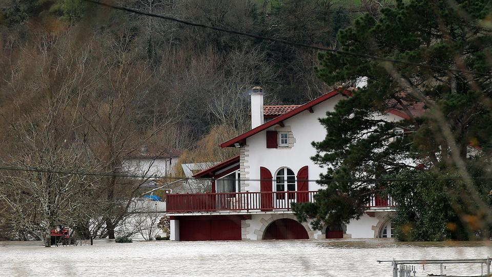 A flooded house in Guiche, near Peyrehorade, southwestern France, caused by heavy rains in Guiche, Saturday, Dec.14, 2019. Southwestern France is on alert for violent storms, high winds and floods.