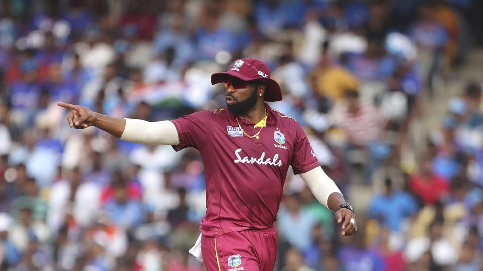 Kieron Pollard directs his teammates to their fielding positions during the first ODI between India and West Indies.