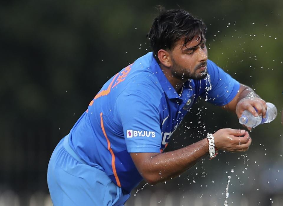 Rishabh Pant splashes cold water on his face during the first one day international cricket match between India and West Indies. (AP)