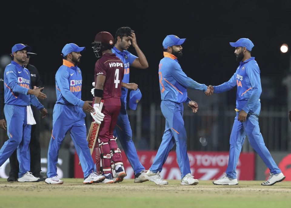 West Indies' Shai Hope, third left, greets Indian players. (AP)