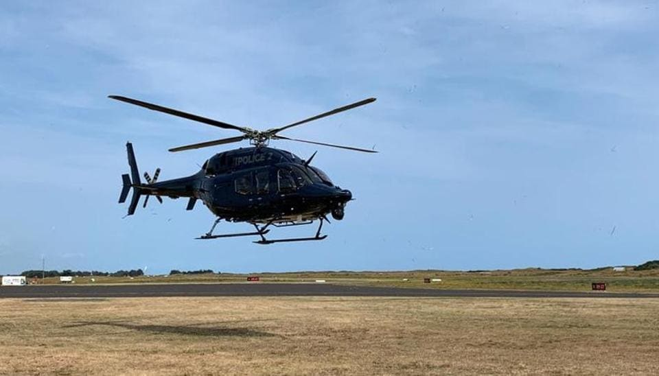 A New Zealand Police helicopter returns to Whakatane Airport after conducting a search for bodies in the aftermath of the eruption of White Island volcano,  December 15, 2019.