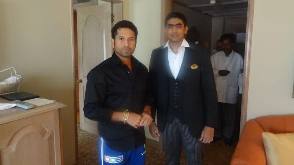 File photo of Sachin Tendulkar with Taj hotel worker Guruprasad.