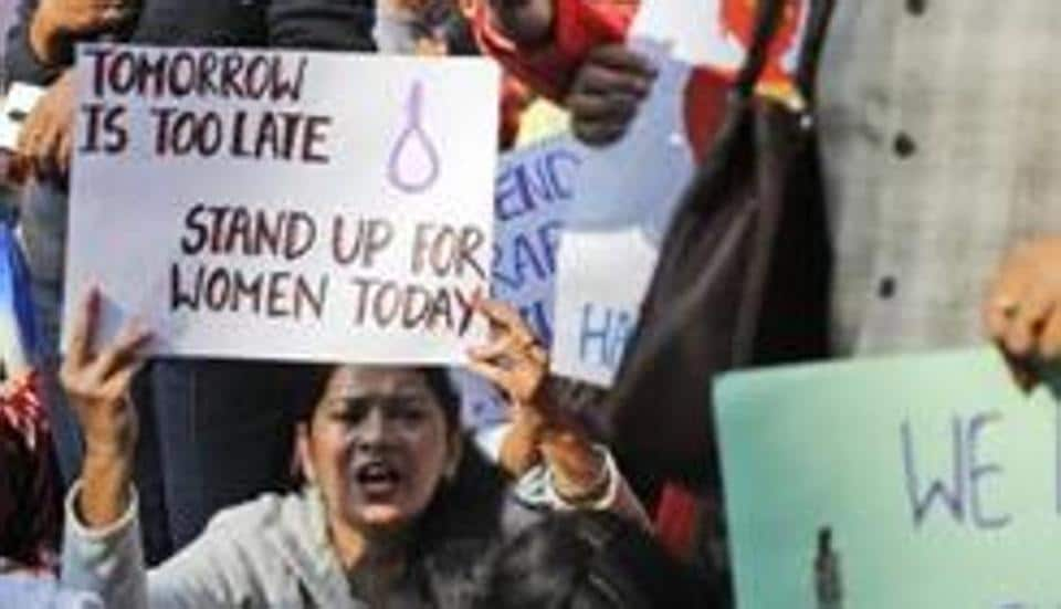 Women activists hold banners and shout slogans demanding justice in the case of a veterinarian who was gang-raped and killed last week, during a protest in New Delhi, India, Tuesday, Dec. 3, 2019.