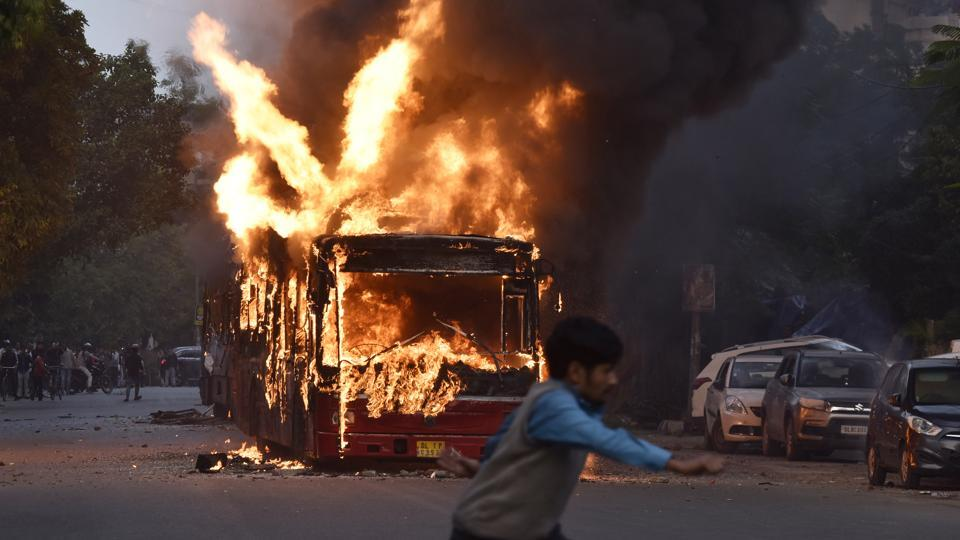 Violence over the amended citizenship act rocked the national capital on Sunday, with public buses being set on fire in a busy south Delhi colony and police using tear gas on protesters gathered near Jamia Millia Islamia, an area that has remained tense following Friday's clashes over the new law that has also roiled the North-east over the past week. (Sanjeev Verma / HT Photo)