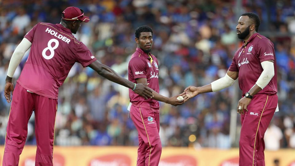 West Indies' Keemo Paul, center, celebrates with teammates the dismissal of India's Kedar Jadhav during the first one day international cricket match between India and West Indies in Chennai, India, Sunday, Dec. 15, 2019.